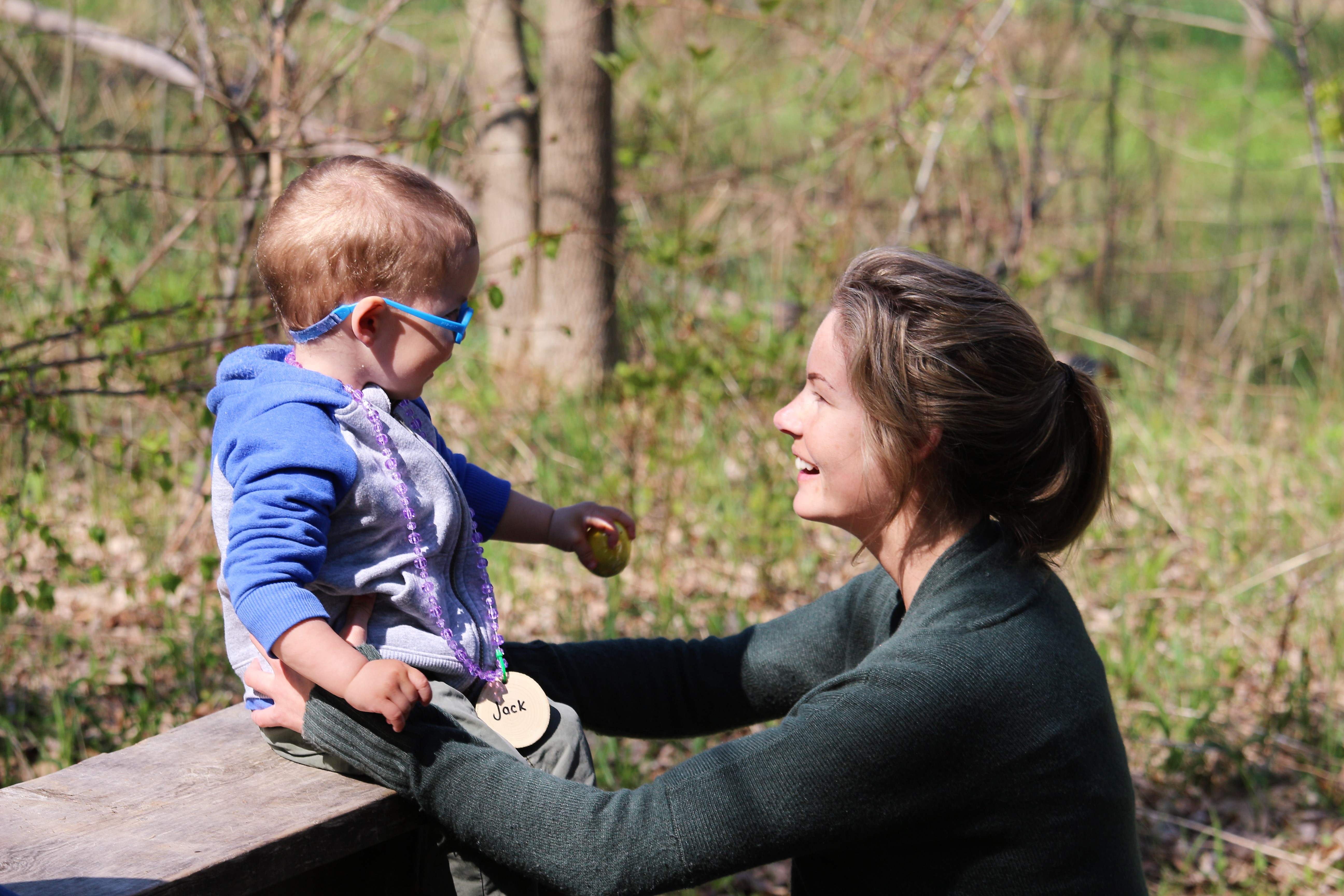 A mom and her daughter  looking at each other in the forest at Scanlon Creek.