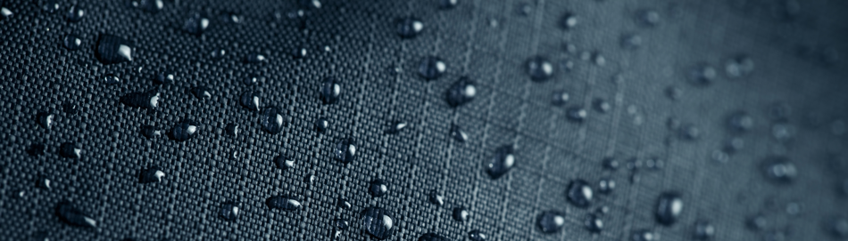 A photo of water beading on top of a waterproof material.