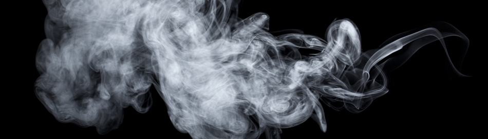 Smoke steam from vaping on a black background.