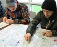 Two students looking at a map.